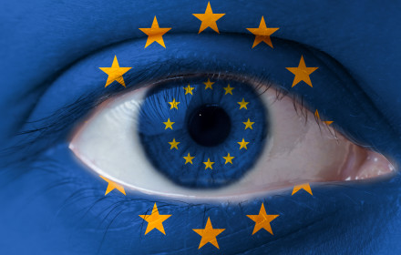 Human face painted with flag of European Union EU on the face and the iris. The concept of the eusopean view of life.
